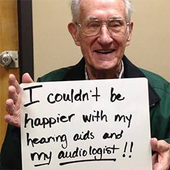 Happy man with hearing aids
